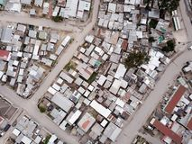 Aerial view over South African township. Aerial view over a South African township, from overhead stock images