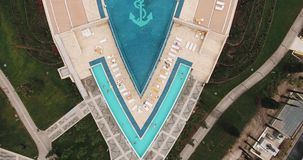 Aerial view over swimming pool of expensive hotel with fountain on summer day stock video footage