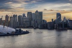 Aerial view over the Thames in London to the financial district Canary Wharf stock image
