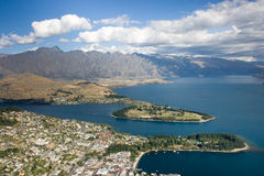 Aerial view over town, lake and mountains. View from the mountain tor over Queenstown, Central Otago, New Zealand stock photography