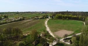 Aerial view over traditional Ukrainian village in spring, Pirogovo, KIev. Aerial view over traditional Ukrainian village in spring. Museum of national stock footage