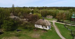 Aerial view over traditional Ukrainian village in spring, Pirogovo, KIev. Aerial view over traditional Ukrainian village in spring. Museum of national stock video footage