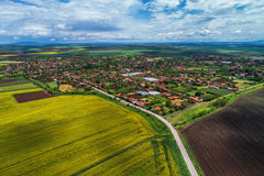 Aerial view over Village countryside in the middle of the valley Royalty Free Stock Photo