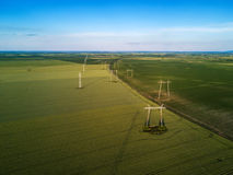 Aerial view of overhead electricity power line pylons Royalty Free Stock Photography