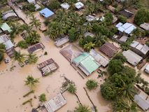 Aerial view overhead houses flooded by a cyclone. Aerial view overhead flooded houses after a cyclone royalty free stock photos