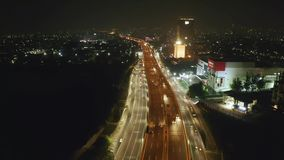 Aerial view of overpass tollway at night stock video footage