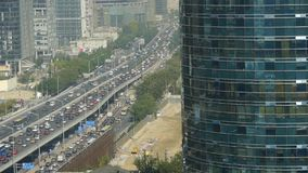 Aerial view of overpass traffic at city,business building reflect. stock video