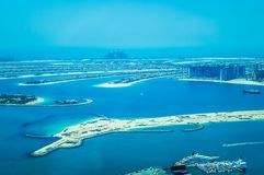 Aerial view of Palm Jumeirah Island with luxury yachts in the front. stock photo