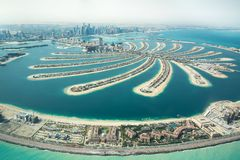 Aerial view of Palm Jumeirah man made island. Aerial view of Palm Jumeirah man made island and Dubai Marina and JBR district on a sunny day. as viewed from a stock photo