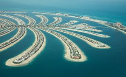 Aerial view of Palm Jumeirah man made island. Aerial view of Palm Jumeirah man made island and Dubai Marina and JBR district on a sunny day. as viewed from a royalty free stock photos