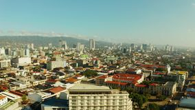 Modern city of Cebu with skyscrapers and buildings, Philippines. Aerial view of panorama of the city of Cebu with skyscrapers and buildings in the early morning stock video footage
