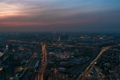 Aerial view panorama of night city Moscow, Russia. Urban cityscape after sunset with illuminated streets and building Royalty Free Stock Images