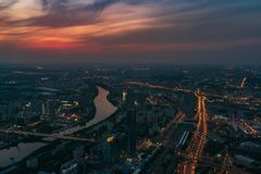 Aerial view panorama of night city Moscow, Russia. Urban cityscape after sunset with illuminated streets and building Royalty Free Stock Photo