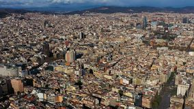 Aerial view panorama to Barcelona Spain from Gothic Quarter to center with Sagrada familia and Torre Glories Torre Agbar. Video footage. Sunny top view stock footage