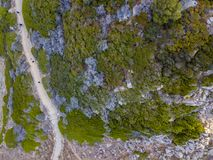 Aerial view of the panoramic path that leads to the bloody islands. Corsica, France. Aerial view of the panoramic path that leads to the promontory view point to stock images