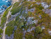 Aerial view of the panoramic path that leads to the bloody islands. Corsica, France. Aerial view of the panoramic path that leads to the promontory view point to royalty free stock images