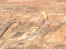 Aerial view of paraglider flying on sunny day royalty free stock photo