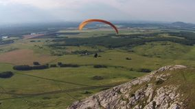 Aerial view of paragliding near the mountain solitary Toratau stock video footage