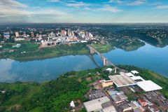 Aerial view of the Paraguayan city of Ciudad del Este. And Friendship Bridge, connecting Paraguay and Brazil through the border over the Parana River, with Stock Photos