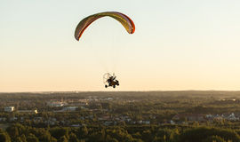 Aerial view of paramotor flying over the city Royalty Free Stock Photography