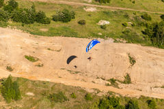 Aerial view of paramotor flying over the fields Royalty Free Stock Image