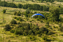 Aerial view of paramotor flying over the fields Royalty Free Stock Photo