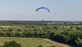 Aerial view of paramotor flying over the fields Royalty Free Stock Photos