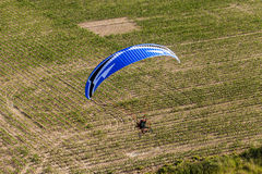 Aerial view of paramotor flying over the fields Stock Photo