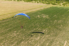 Aerial view of paramotor flying over the fields Stock Image