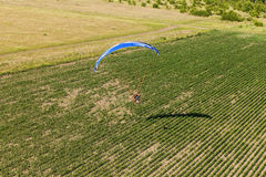 Aerial view of paramotor flying over the fields Stock Images