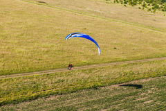 Aerial view of paramotor flying over the fields Royalty Free Stock Photography