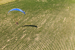 Aerial view of paramotor flying over the fields Stock Photos