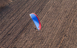 Aerial view of paramotor flying over the harvest field Royalty Free Stock Images