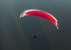 Aerial view of paramotor flying over the river Stock Photos