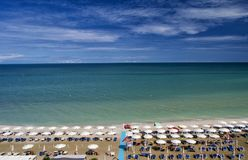 Aerial view of parasols and beachline in Marotta. For travel and holiday concepts Royalty Free Stock Images