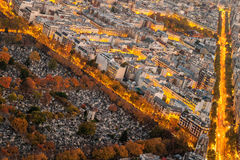 Aerial view of Paris in autumn from the Montparnasse Tower with cemetery versus traffic and buildings. Stock Photography