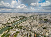 Aerial view of Paris cityscape including the River Seine under a cloudy blue sky. Aerial view of Paris cityscape including the River Seine, with buildings going Stock Photography