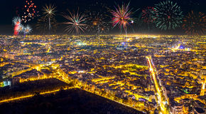 Aerial view of Paris, France with fireworks in the sky. Royalty Free Stock Image