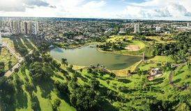 Aerial view from a park of the city of Campo Grande MS. Aerial view from the lake of Parque Das Nacoes Indigenas, the biggest park of the city, with a huge green royalty free stock images