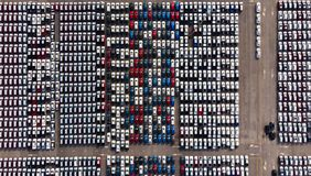 Aerial view of a parking lot new cars lined up in the port for i. Mport and export royalty free stock image
