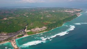 Aerial view of part island, turquoise ocean waves, villas in green, landscape. Aerial view of part tropical island, turquoise ocean waves, villas in green stock video