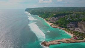 Aerial view of part island, turquoise ocean waves, villas in green, landscape. Aerial view of part tropical island, turquoise ocean waves, villas in green stock footage