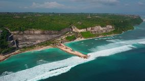 Aerial view of tropical beach, turquoise ocean waves, villas in green, landscape. Aerial view of part tropical island, turquoise ocean waves, villas in green stock footage