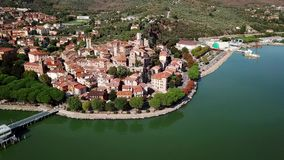 Aerial view of Passignano sul Trasimeno Tuscany Italy. Drone video footage - Aerial view of Passignano sul Trasimeno Tuscany Italy stock video footage