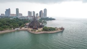 Aerial view of Pattaya with ancient temple Sanctuary of Truth and modern skyscrapers royalty free stock photo