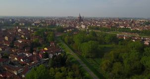 Aerial view of Pavia and the Ticino River, Lombardia, Italy. Aerial view of Pavia and the Ticino River, View of the Cathedral of Pavia, Covered Bridge and the stock video