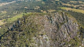 Aerial view of peak Mt Cooroora on Sunshine Coast, Australia. Aerial view of volcanic peak Mt Cooroora on Sunshine Coast, Queensland, Australia stock footage