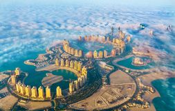 Aerial view of the Pearl-Qatar island in Doha through the morning fog - Qatar, the Persian Gulf. Aerial view of the Pearl-Qatar island in Doha through the Stock Photo