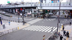 Aerial View Pedestrians Crossing Crosswalk Cars Traffic in Japan Stock Photography