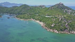 Aerial view peninsula rocky coast washed by Azure ocean stock video footage